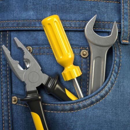 tools-in-jeans-pocket-service-and-engineering-conc-DXPE22J